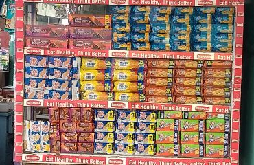 stacks of products in small Indian mobile shop