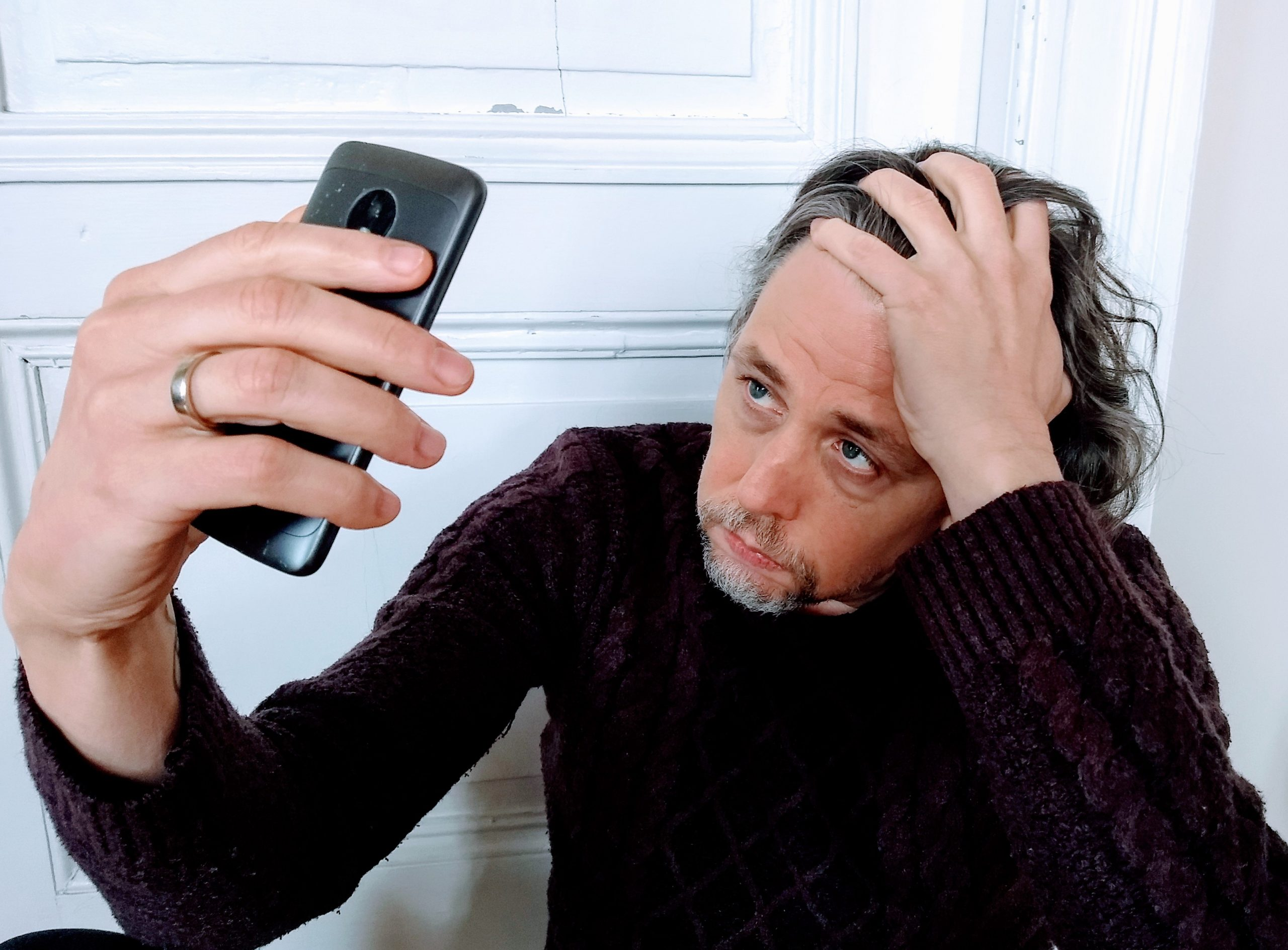Frank During looking at his phone in desperation